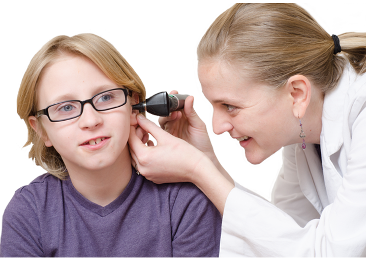 Doctor looking in childs ear